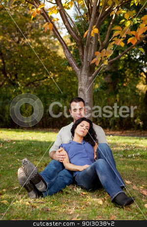 Couple Rest Park stock photo, A couple relaxing in the park by a tree by Tyler Olson