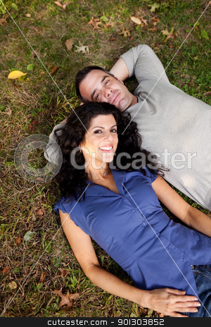 Couple Dream stock photo, A couple in the park laying on the grass.  Sharp focus on female. by Tyler Olson