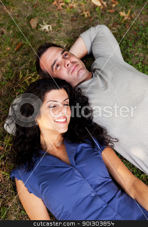 Daydream stock photo, A couple day dreaming while laying on grass by Tyler Olson