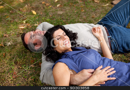 Park Relax stock photo, A couple laying on grass in a park by Tyler Olson