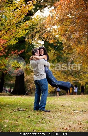 Man Woman Hug stock photo, A man giving a bear hug to a woman  by Tyler Olson