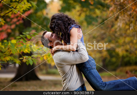 Healthy Relationship stock photo, A man giving a woman a big hug in a park by Tyler Olson