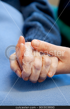Elderly Care stock photo, A young hand touches and holds an old wrinkled hand by Tyler Olson