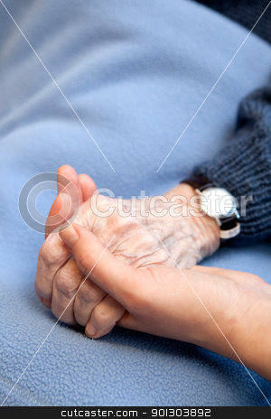 Old Hands stock photo, An old handing holding a young hand.  Shallow depth of field with focus on the hands. by Tyler Olson