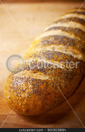Fresh Bread stock photo, Fresh home-made onion and rice bread garnished with poppy seeds by Tyler Olson