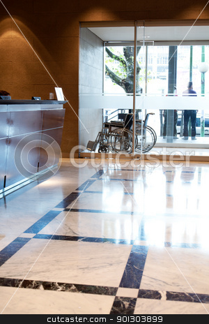 Hospital Inteior stock photo, An hospital entry with wheel chair and reception by Tyler Olson
