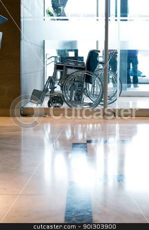 Wheelchair in Reception Entry stock photo, A wheelchair in a reception area of a hotel or hospital by Tyler Olson