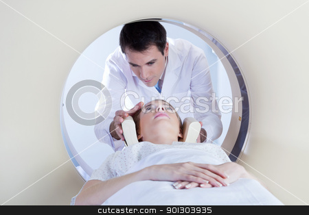 Patient going through MRI test stock photo, Technologist preparing the patient for a CT scan in hospital by Tyler Olson