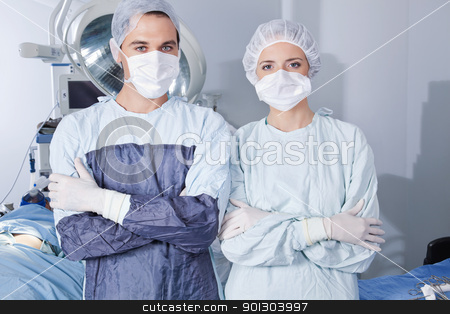 Young confident surgeons stock photo, Portrait of young confident surgeons in operation theatre by Tyler Olson
