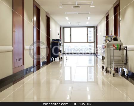 Empty hallway of hospital stock photo, Interior of clean reflective empty hallway of hospital by Tyler Olson