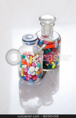Medical drugs in a bottle stock photo, Bottle of tablets, capsules and medical drug by Tyler Olson