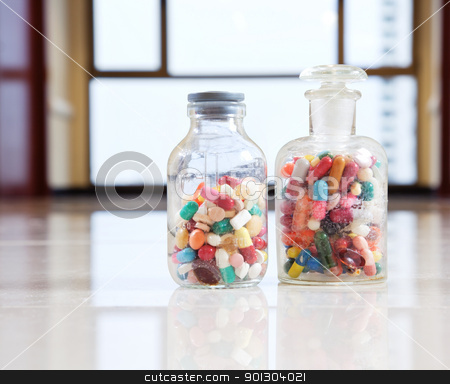 Tablets and capsules stock photo, Bottles with tablets and capsules by Tyler Olson