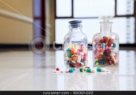 Medical capsules and tablets in a bottle stock photo, Bottle of tablets, capsules and medical drug by Tyler Olson