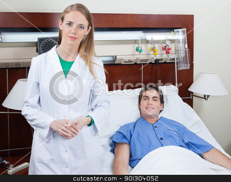 Confident female doctor with patient stock photo, Portrait of confident young female doctor with patient in hospital by Tyler Olson