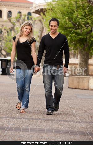 European Couple Walk stock photo, A couple walking outdoors in an urban landscape. by Tyler Olson