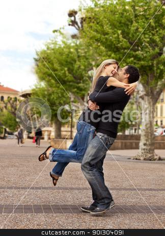 Lift Hug - Happy European Couple stock photo, A happy european couple - the man lifting and hugging the woman by Tyler Olson