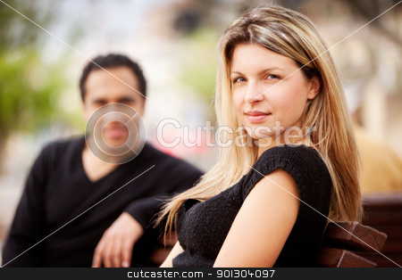 Happy French Woman stock photo, A french couple sitting on a city park bench by Tyler Olson