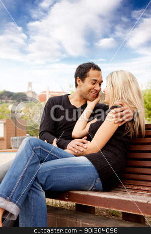 Happy French Couple stock photo, A happy french couple sitting in an urban city park by Tyler Olson