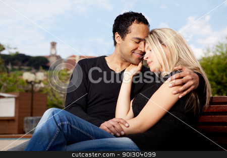 City Hug stock photo, A happy french couple hugging in an urban park by Tyler Olson