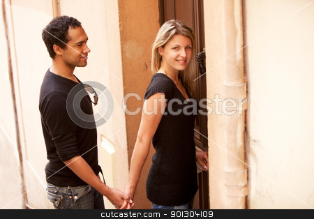 French European Couple stock photo, A happy couple in an outdoor European quaint street by Tyler Olson