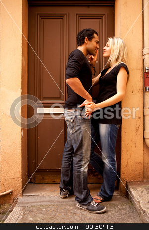Europe Couple Flirt stock photo, An attractive couple flirting in an outdoor European setting by Tyler Olson