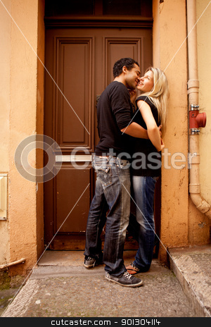 Flirt Couple stock photo, A couple having fun and flirting in an European French Street by Tyler Olson