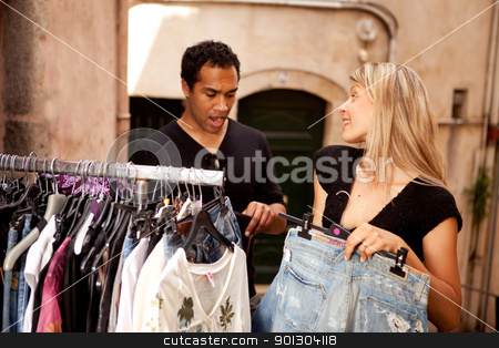 Shopping Budget  stock photo, A man and woman shopping, going over the budget - shallow depth of field, focus on woman. by Tyler Olson