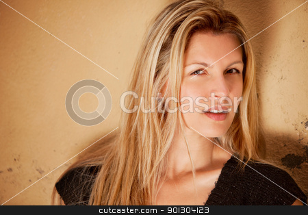 Beautiful European Woman stock photo, A casual street portrait of a happy attractive european woman by Tyler Olson