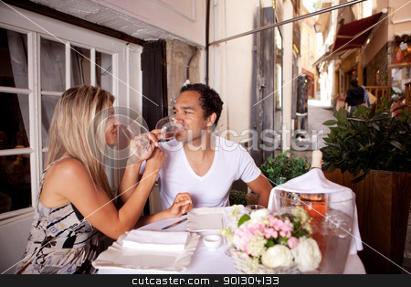 European Cafe Couple stock photo, A happy couple drinking wine in a cafe in France by Tyler Olson