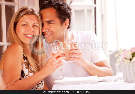 Happy Couple stock photo, A happy couple in a outdoor restaurant on a date by Tyler Olson