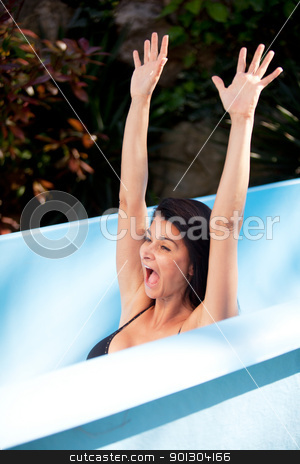 Woman on Waterslide stock photo, A womain on a water slide  having fun by Tyler Olson