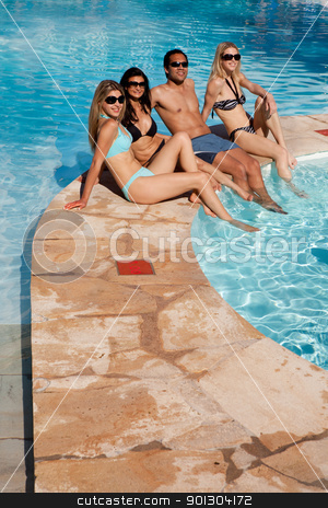 Pool Friends Relax stock photo, A group of friends relaxing at and outdoor hotel pool by Tyler Olson