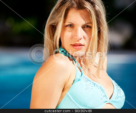 Woman Portrait Bikini stock photo, A portrait of an attractive woman in a bikini beside a pool by Tyler Olson