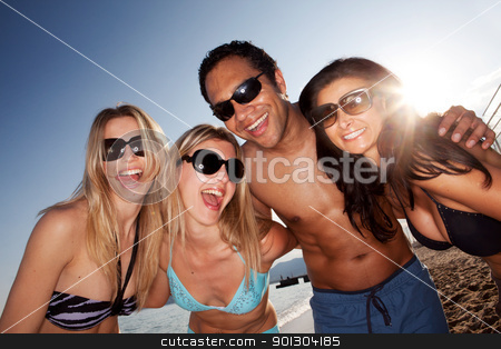 Happy Beach portrait stock photo, A group of crazy friends on the beach having fun by Tyler Olson