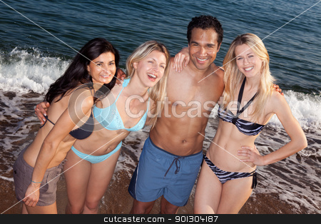 Beach People stock photo, A group of friends smiling having fun at the beach by Tyler Olson