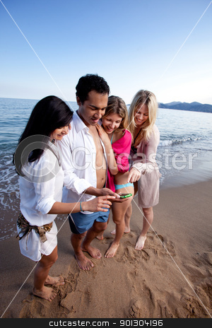 Cellphone stock photo, A group of friends looking and pointing and a cellphone by Tyler Olson