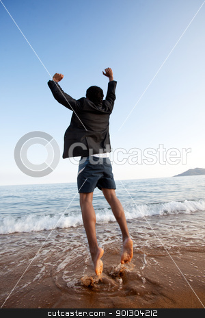 Free Business Man stock photo, A business man jumping on the beach, freedom, success concept by Tyler Olson