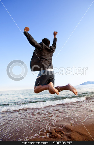 Success Business stock photo, A happy business man jumping by the ocean - happy successful concept by Tyler Olson
