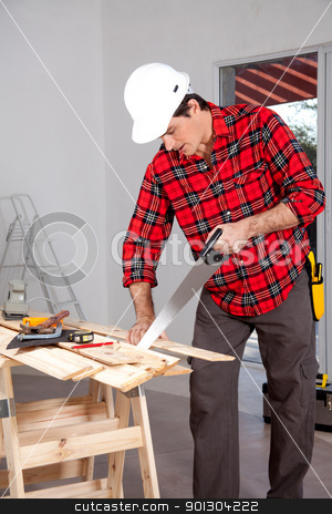 Hand Saw Wood Working stock photo, A wood worker using a hand saw in a home interior by Tyler Olson