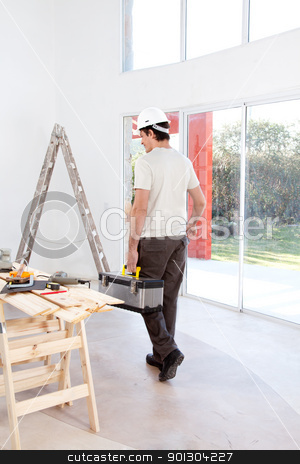 Home Improvement stock photo, A faceless man with a tool chest, working on home improvements by Tyler Olson