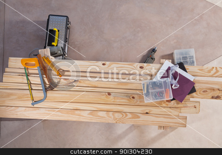 Set of construction tools stock photo, Set of construction tools lying on wooden plank by Tyler Olson