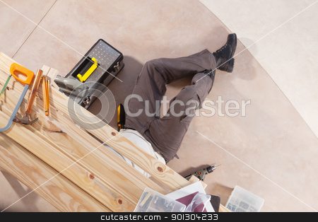 Carpenter at work stock photo, Carpenter working under the table with carpentry tools around by Tyler Olson
