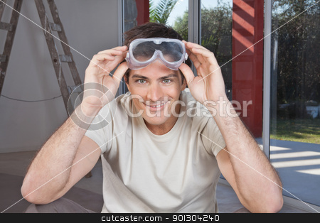 Portrait of a young man stock photo, Portrait of a young smiling man with goggles by Tyler Olson