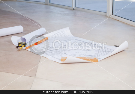 Blueprint on the floor stock photo, Blueprint on the floor with measuring tape and ruler by Tyler Olson