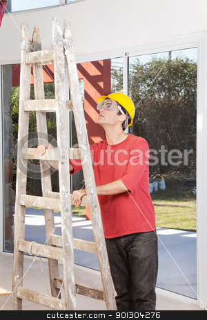 Engineer with ladder stock photo, Engineer wearing helmet and eyegear and holding ladder by Tyler Olson