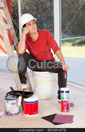 Tired Painter stock photo, A painter sitting on a paint can, tired and resting by Tyler Olson