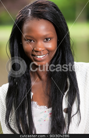Close-up of confident young woman stock photo, Close-up of confident young African American woman by Tyler Olson