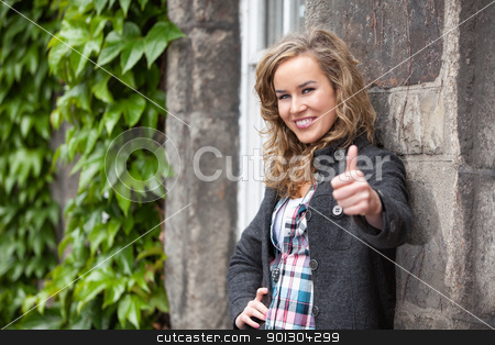 Female with thumbs up stock photo, Happy young female smiling and showing thumb by Tyler Olson