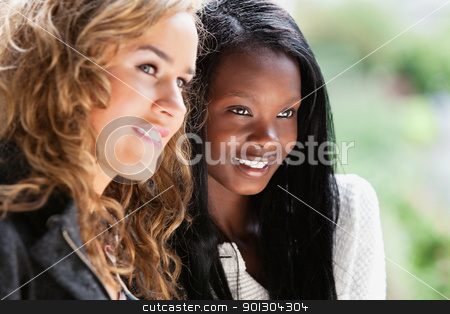 Happy young females looking away stock photo, Close-up of two happy young females looking away by Tyler Olson