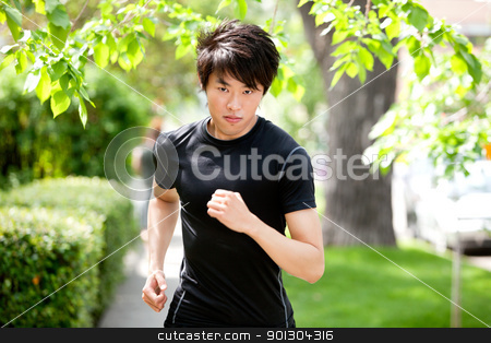 Serious man jogging stock photo, Portrait of a handsome serious man jogging in a park by Tyler Olson